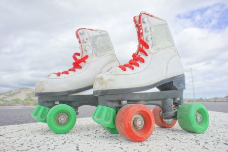 Hdr Picture of Old Vintage White Skate Boot on the Asphalt Sterret photo