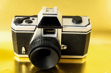 lomography: Classic 35mm Plastic Toy Photo Camera on a Colored Background