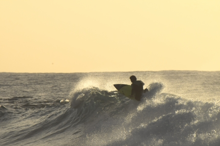 Silhouette Surfer Riding a Big Wave in Tenerife Canary Island Spain