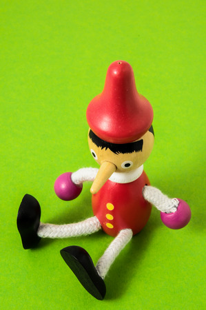 Pinocchio Toy Statue on a Colored  photo