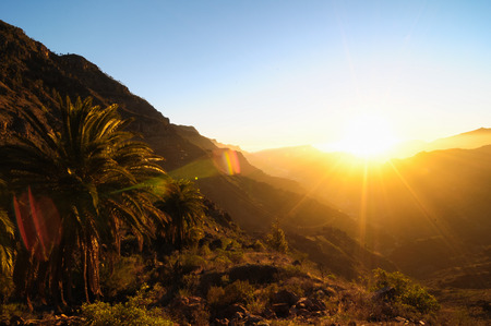 Backlight Silhouette Sunset over the Mountains in Canary Islands Tenerife Stock Photo