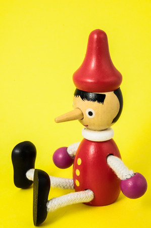 Pinocchio Toy Statue on a Colored Background Stock Photo