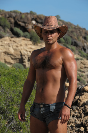 Young Caucasian Muscular Tanned Man in the Desert Tenerife Spain photo