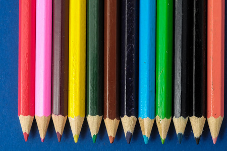New Pencils Textured Set on a Colored Background photo
