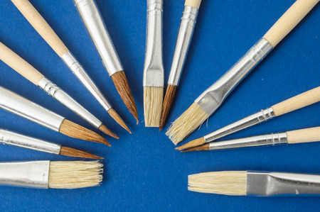 New Wooden Different Paintbrush Set Texture over a Colored  photo