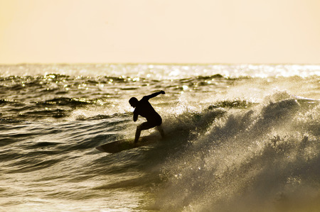 Backlight Silhouette Surfer in the Ocean at Sunset