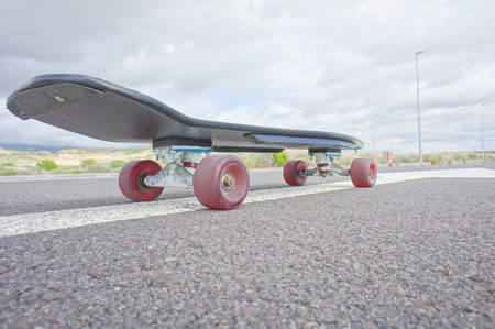 Hdr Picture Vintage Style Longboard Black Skateboard on an Empty Asphalt Desert Road photo