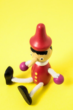 Pinocchio Toy Statue on a Colored Background photo