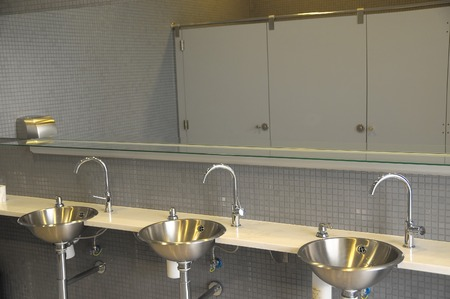An Interior of a Private Restroom with Mirror photo