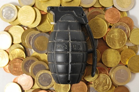 Money for War Concept Hand Grenade and Currency Stock Photo - 26104386