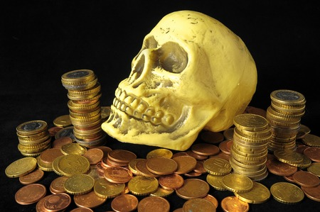 Death Money Concept Skull and Currency over a Black Background photo