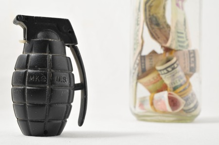 Money for War Concept Hand Grenade and Currency photo