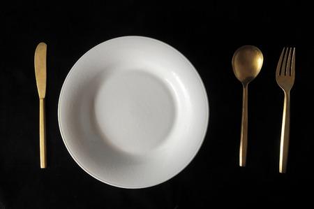 silver flatware: Ancient Vintage Silver Flatware on a Black Background