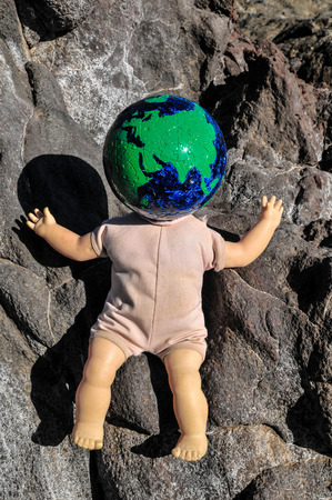 Vintage Old Doll with a Globe Earth Head photo