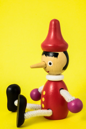 Pinocchio Toy Statue on a Colored Stock Photo - 26121750