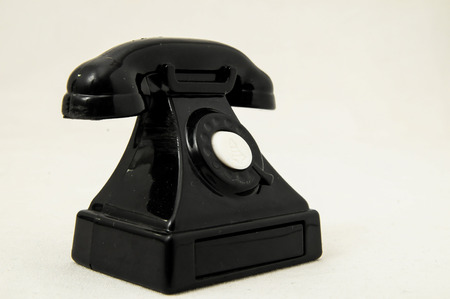 Vintage Old Telephone Plastic Black Toy on a White Background photo