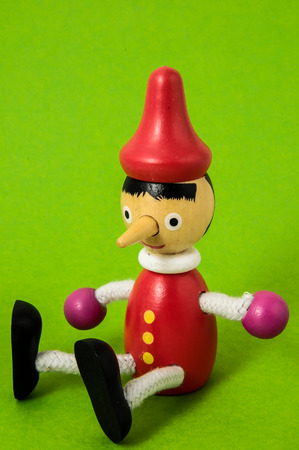 Pinocchio Toy Statue on a Colored Background Banco de Imagens