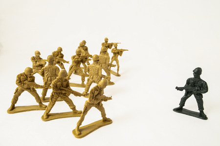 Plastic Lead Soldiers Representing War on a White Background photo