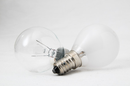 Two Different Old Incandescent Light Bulbs on a White Background photo