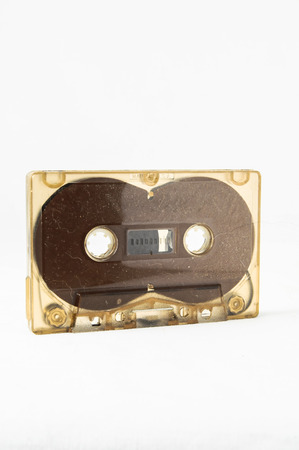 80 s: Ancient Vintage Used Music cassette over a White Background Stock Photo