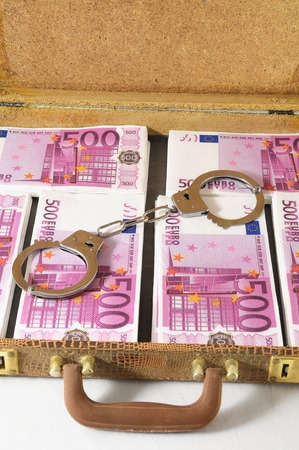One Suitcase Full of Pink 500 Euros Banknotes and Handcuffs photo