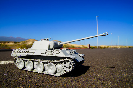 Modern War Concept Model Tank in the Middle of an Asphalt Road photo