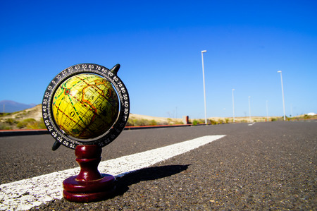 drive around the world: Conceptual Image Globe Earth on an Asphalt Street Stock Photo