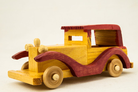 Wooden Toy Red and Yellow Car on a white Backgraund photo
