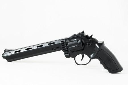 Black Revolver Pistol Gun on a White Background photo
