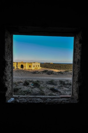 window graffiti: Abandoned Buildings of a Military Base at Sunset