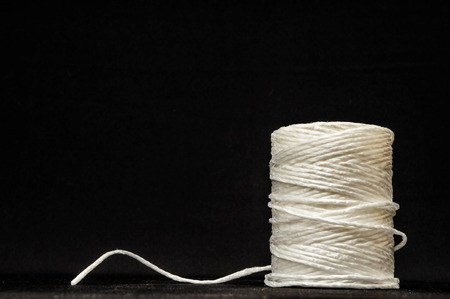 Roll of White Twine on a Black