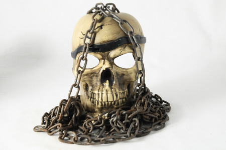 Skull and old Chains on a White  photo