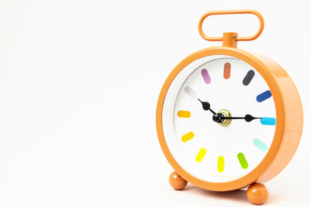 Orange Alarm Clock on a White  photo