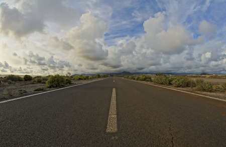 Long Empty Desert Road on a Cludy Day photo