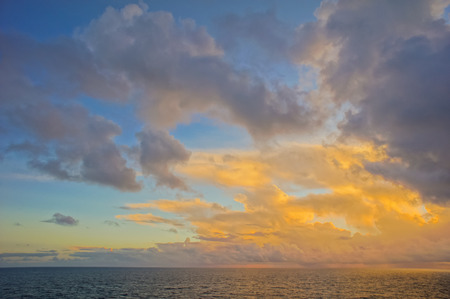HDR Colred Sunrise Clouds over the Atlantic Ocean in Tenerife Canary Islands photo