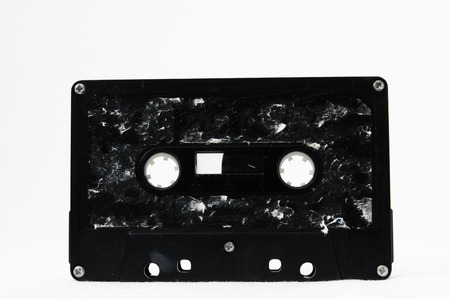 disuse: Ancient Vintage Used Musicassette over a White Background Stock Photo