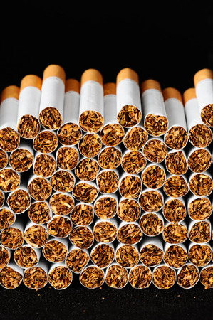 Close-up of Tobacco Cigarettes Background or texture photo