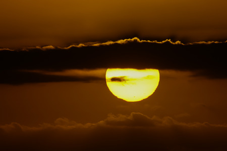 Big Orange Hard Sun at Sunset in the Ocean Canary Island Spain photo