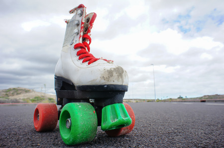 Old Vintage White Skate Boot on the Asphalt Sterret photo