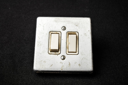 Light switch, old-style on a Black Background photo