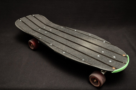 Vintage Style Black Skateboard on a Dark  photo