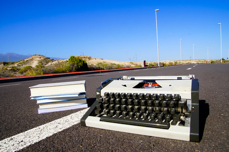 On the Road Writing Concept Typewriter over an Asphalt Street photo