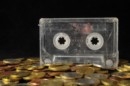 Money Music Concept Tape Musicassette and Coins Stock Photo