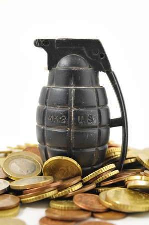 Money for War Concept Hand Grenade and coins photo