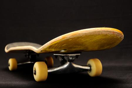 80 s: Vintage Style Black Skateboard on a Dark