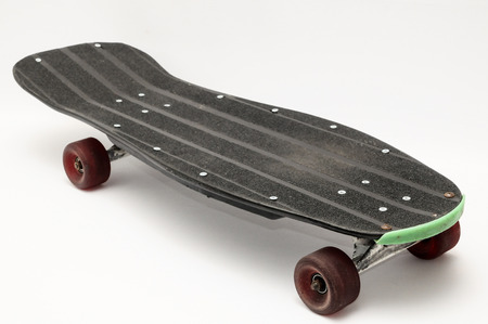 Vintage Style Black Skateboard on a white  photo