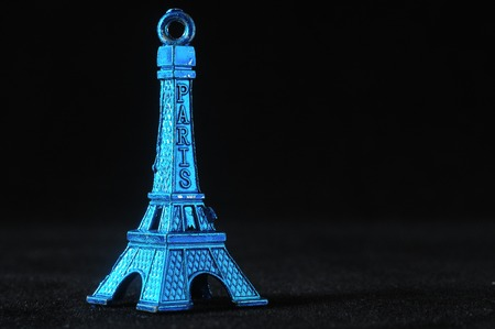 Blue Tour Eiffel Statuette on a Black Background photo