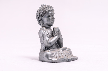 Oriental Asian Statue on a White Background photo