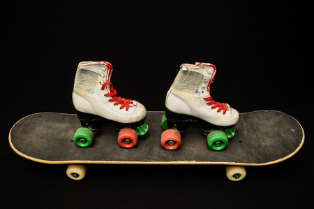 Vintage Style Black Skateboard on a Dark Background photo