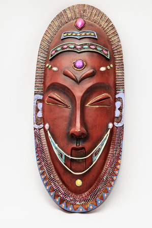 artifact: Wooden African Mask on a White Background Stock Photo